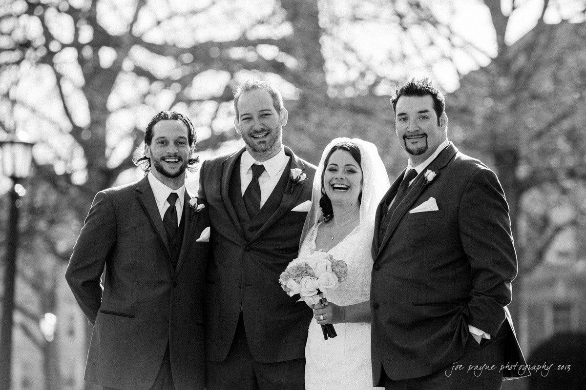 fun groomsmen and bride group shot