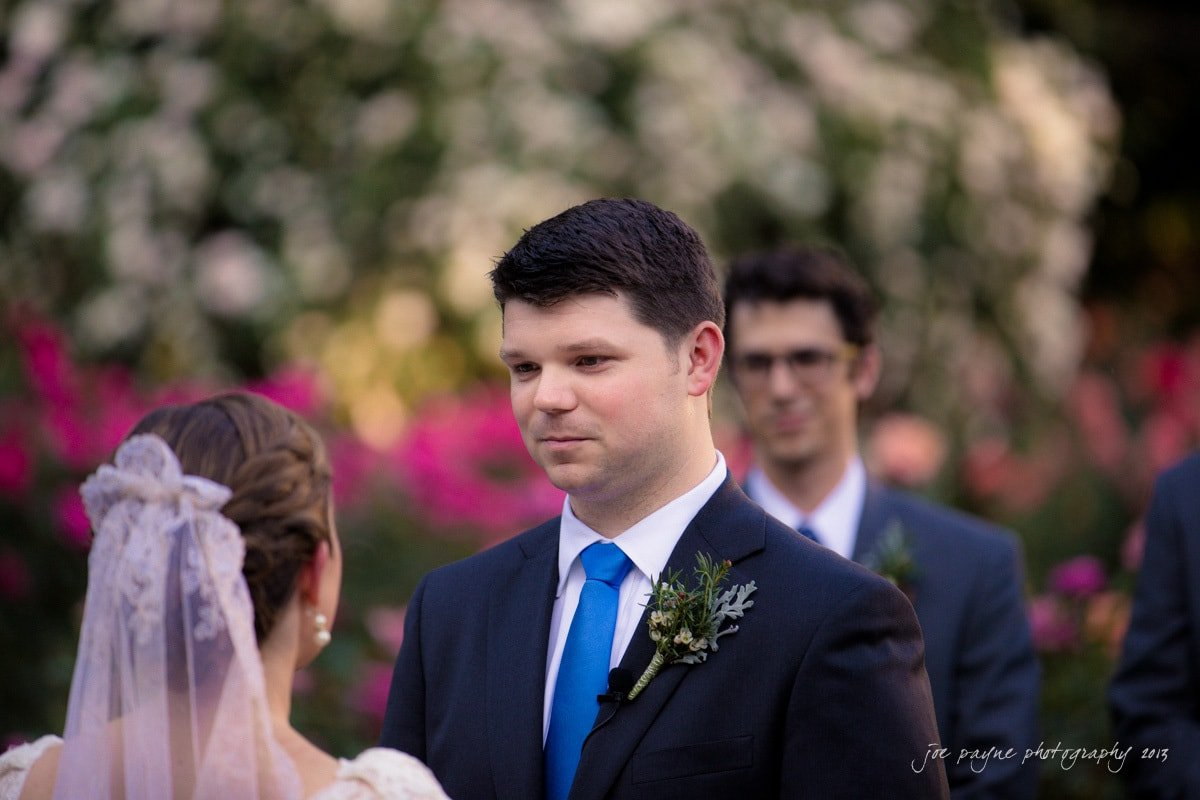 groom listens to his bride's vows