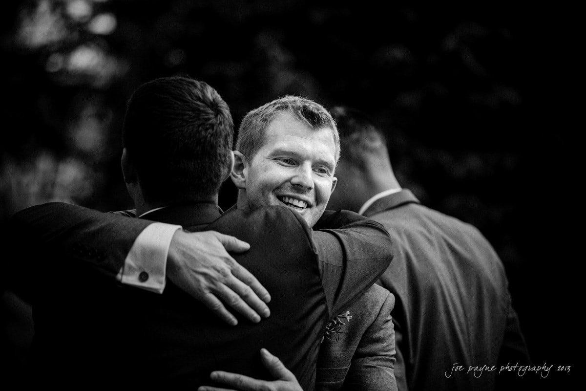 groomsmen congratulate the newlywed groom at raleigh rose garden