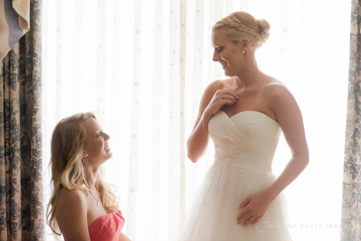 bride and sister get ready at washington duke inn