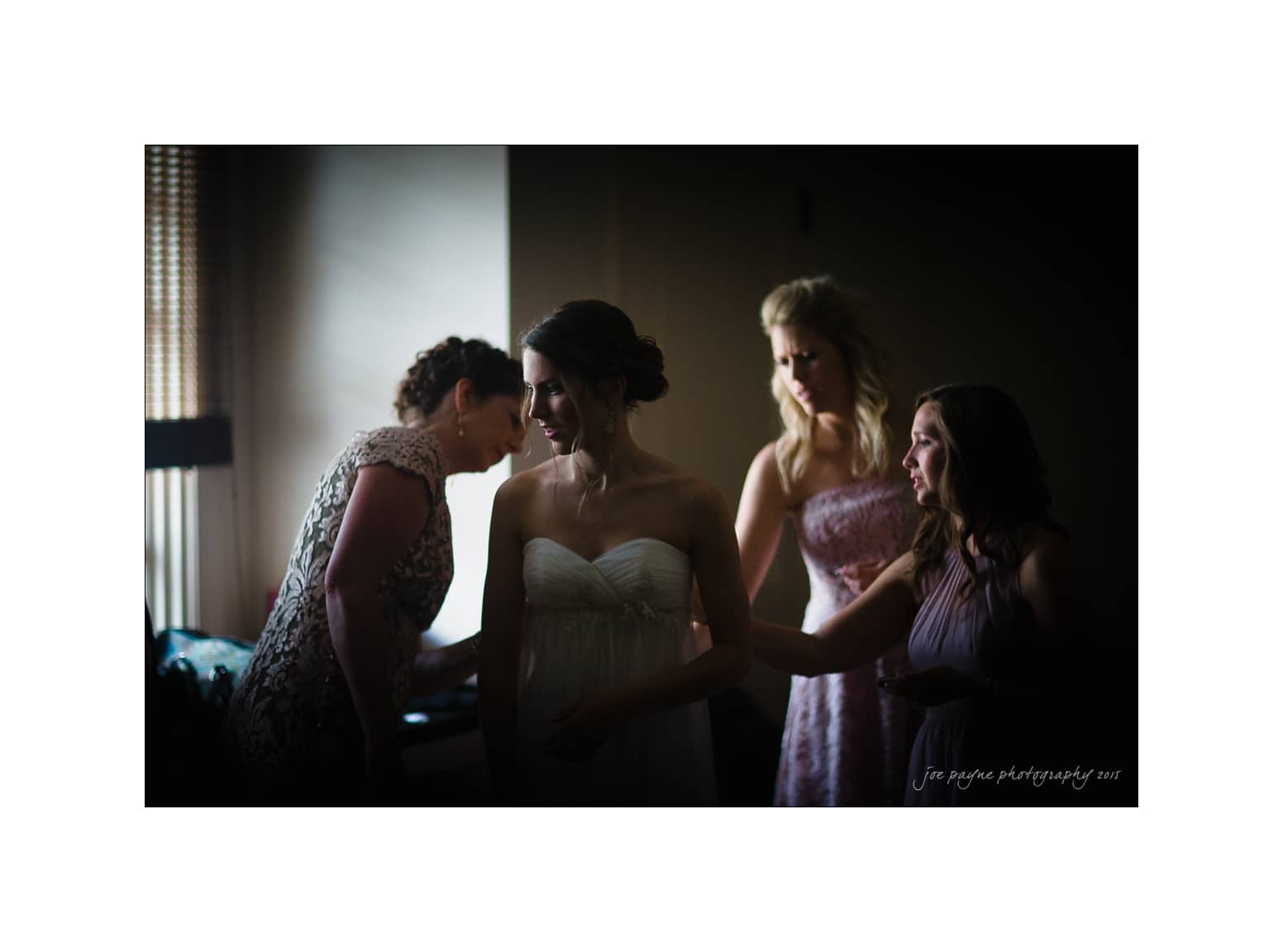 nc wedding photographer bride and bridesmaids fix dress