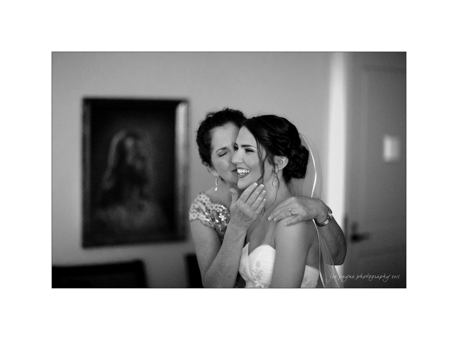 nc wedding photographer mom kisses bride