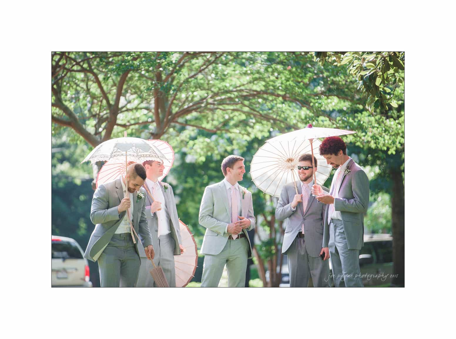 nc wedding photographer groomsmen with parasols