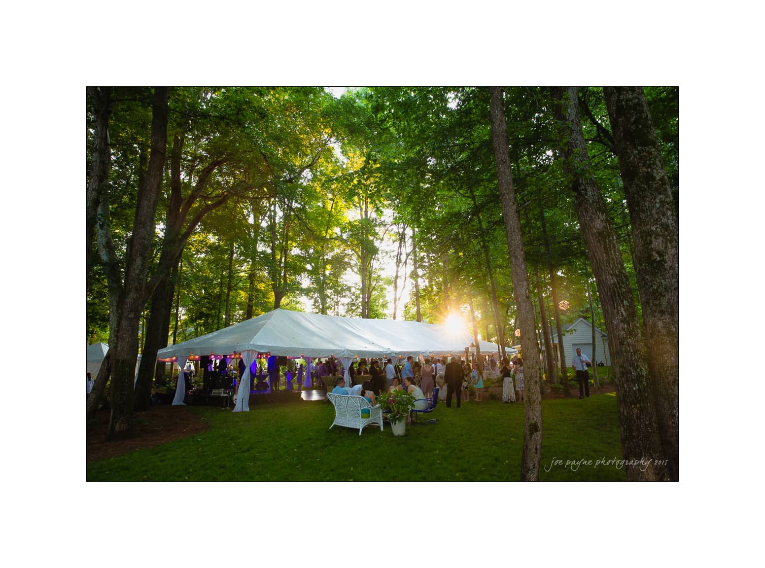 nc wedding photographer backyard reception tent exterior at sunset
