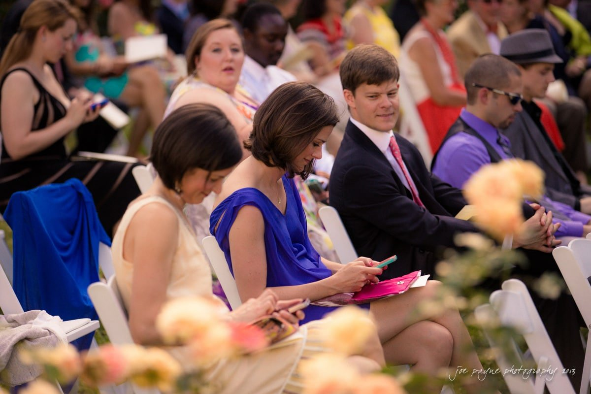 wedding guests checking iPhones