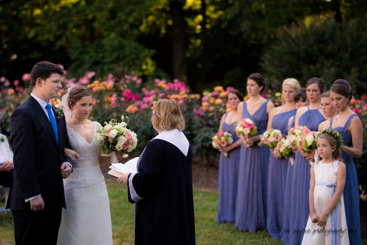 bridesmaids look on at raleigh rose garden