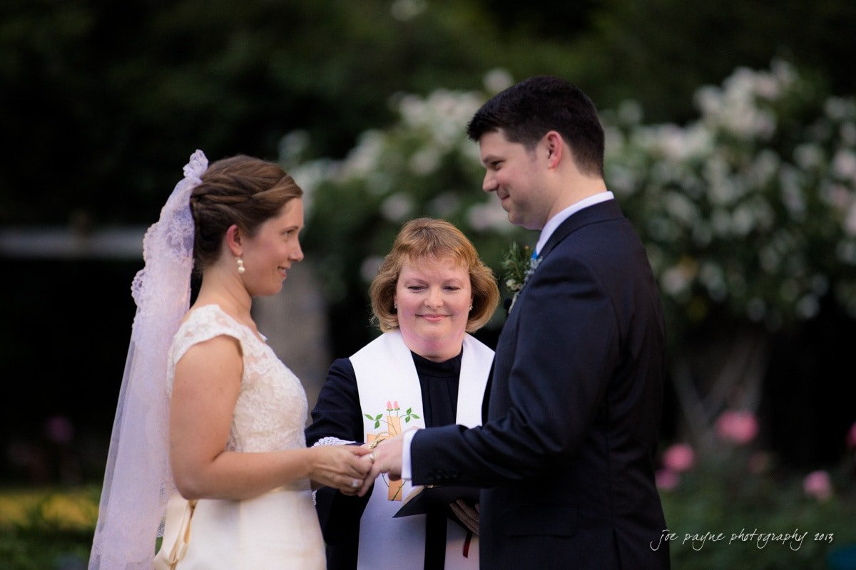exchanging wedding rings at raleigh rose garden