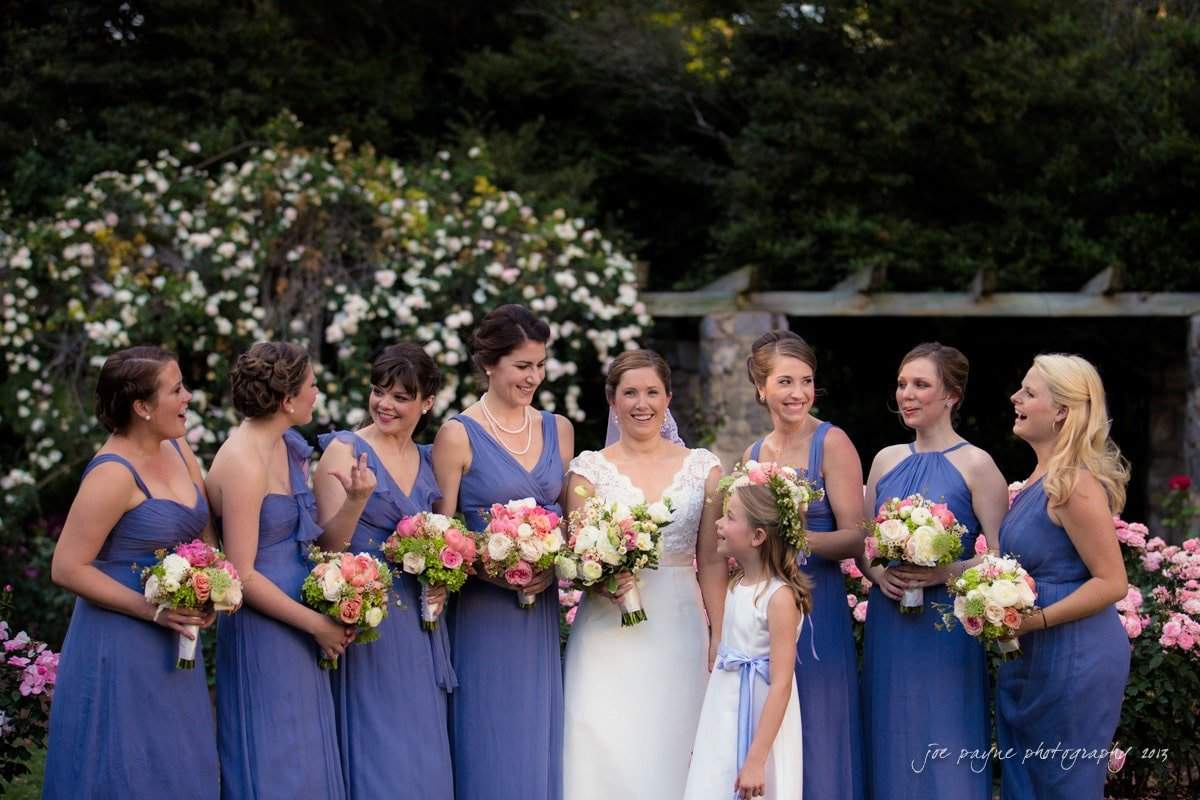 bridesmaids and bride at raleigh rose garden