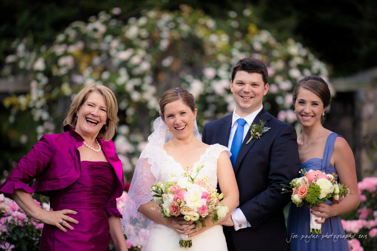 married couple with mom and sister of the bride