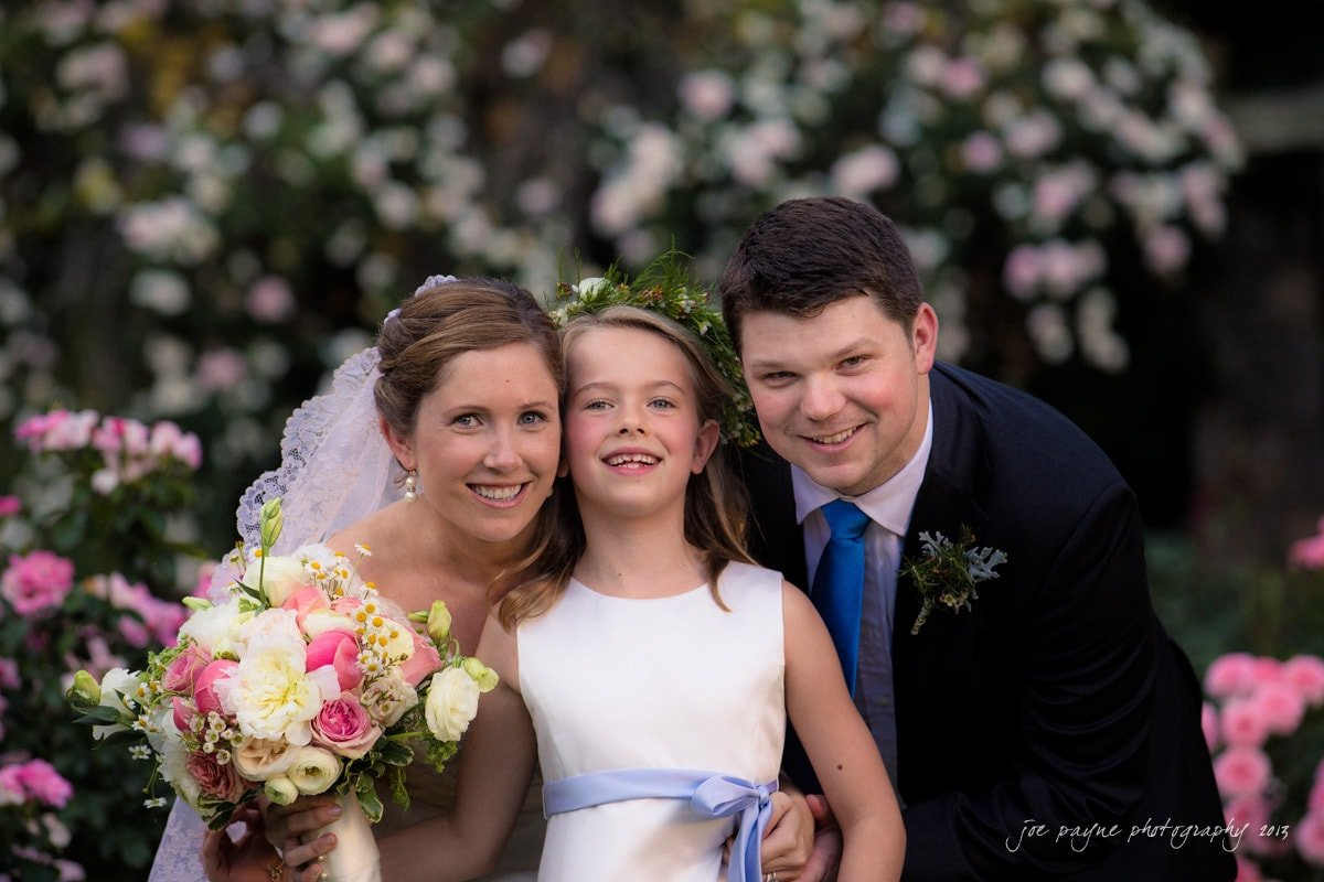married couple with cute flower girl