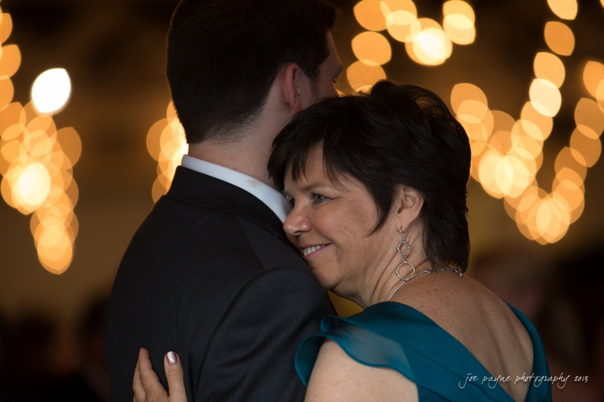 mom and son dance at stockroom wedding