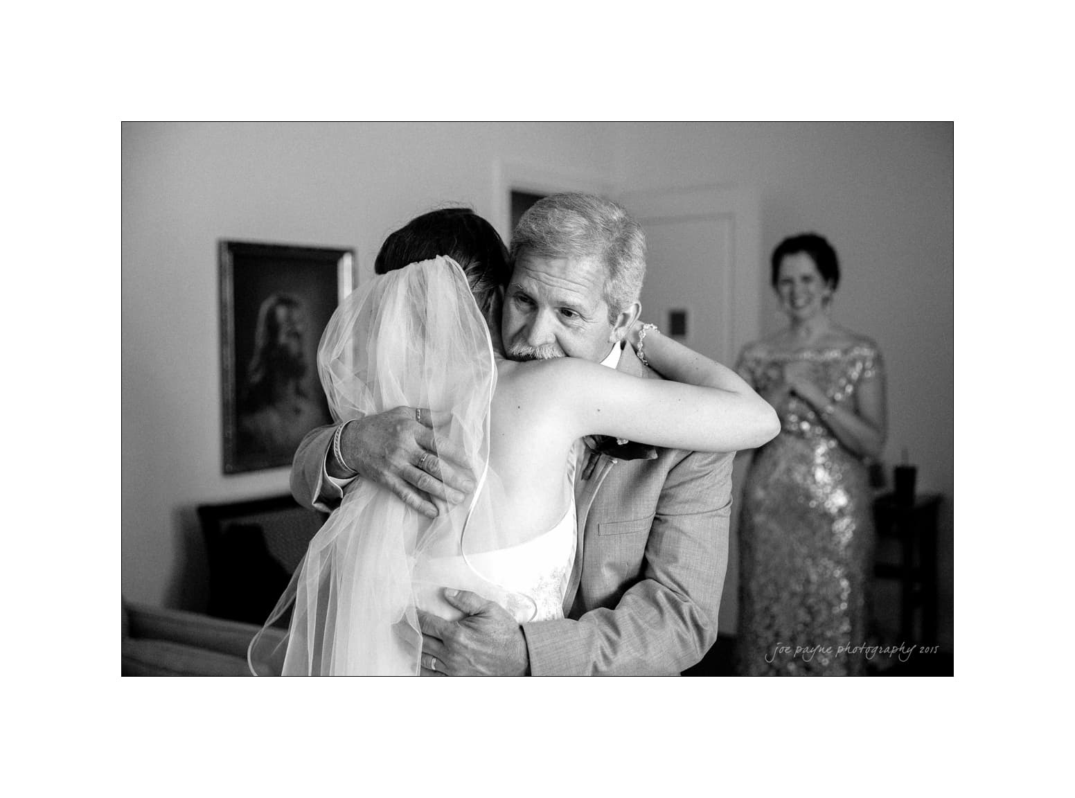 nc wedding photographer emotional dad and mom with bride in dress