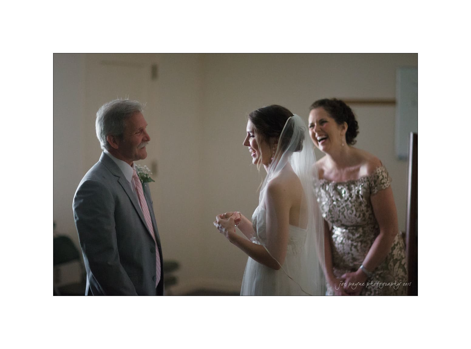 nc wedding photographer mom dad and bride laughing