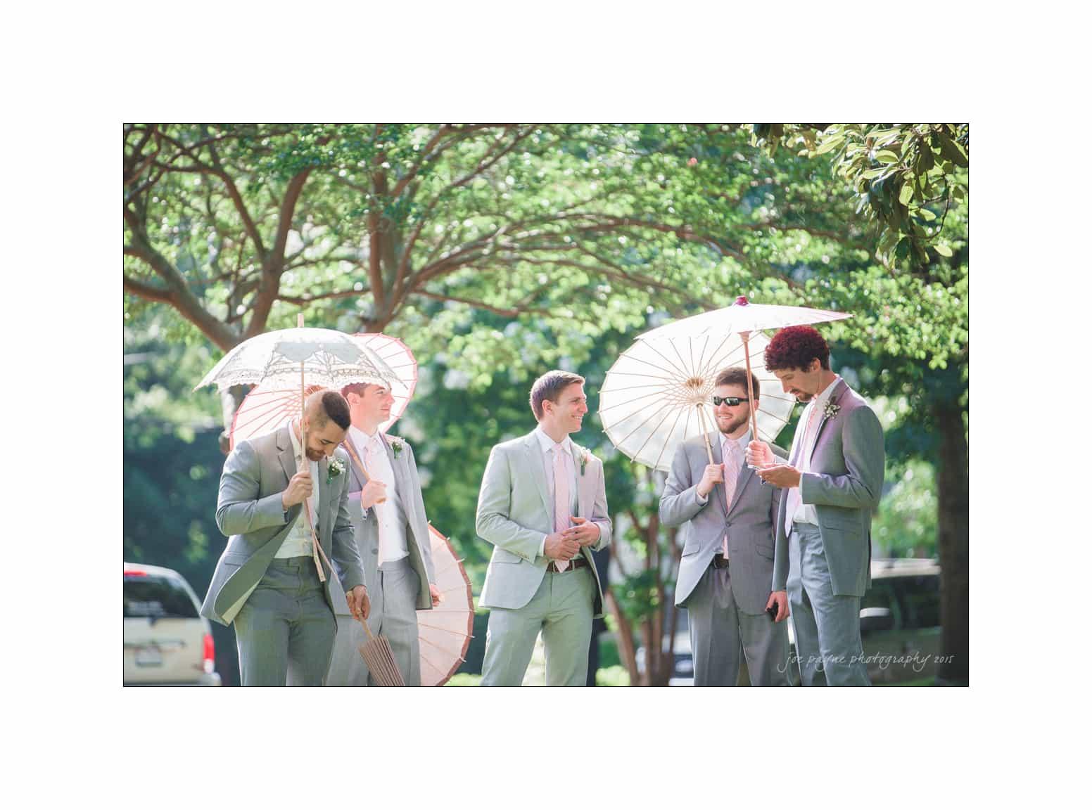 nc wedding photographer groomsmen with parasols