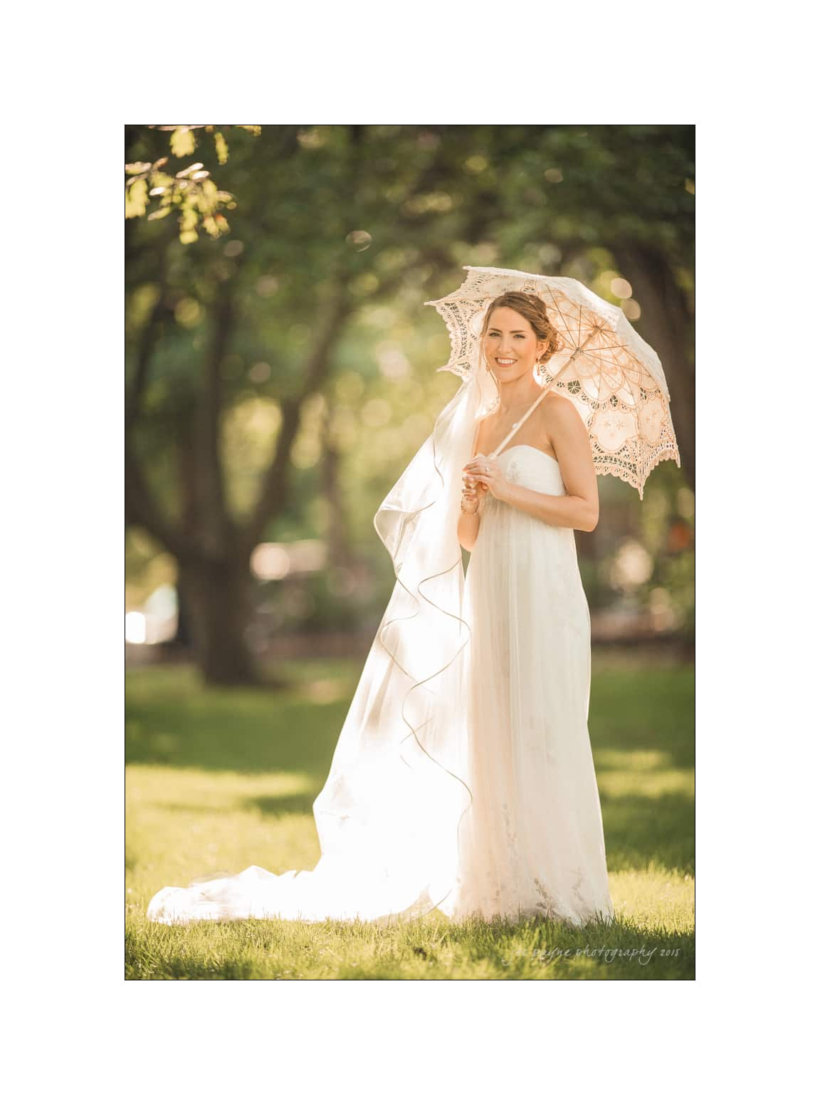 nc wedding photographer beautiful bride with white parasol